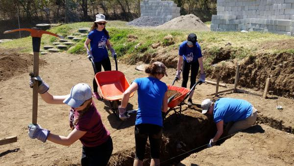 Students digging a trench